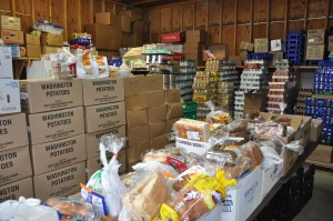 The many food donations recenlty recieved being boxed ready to go.
