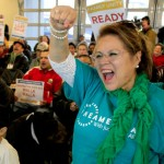 Immigrants and advocates on a multicity bus tour across the state calling for immigration reform hold a rally Wednesday at Casa Latina in Seattle. Lupe Sanchez, at right, from Yakima cheers with the crowd. Photo: Mark Harrison/The Seattle Times