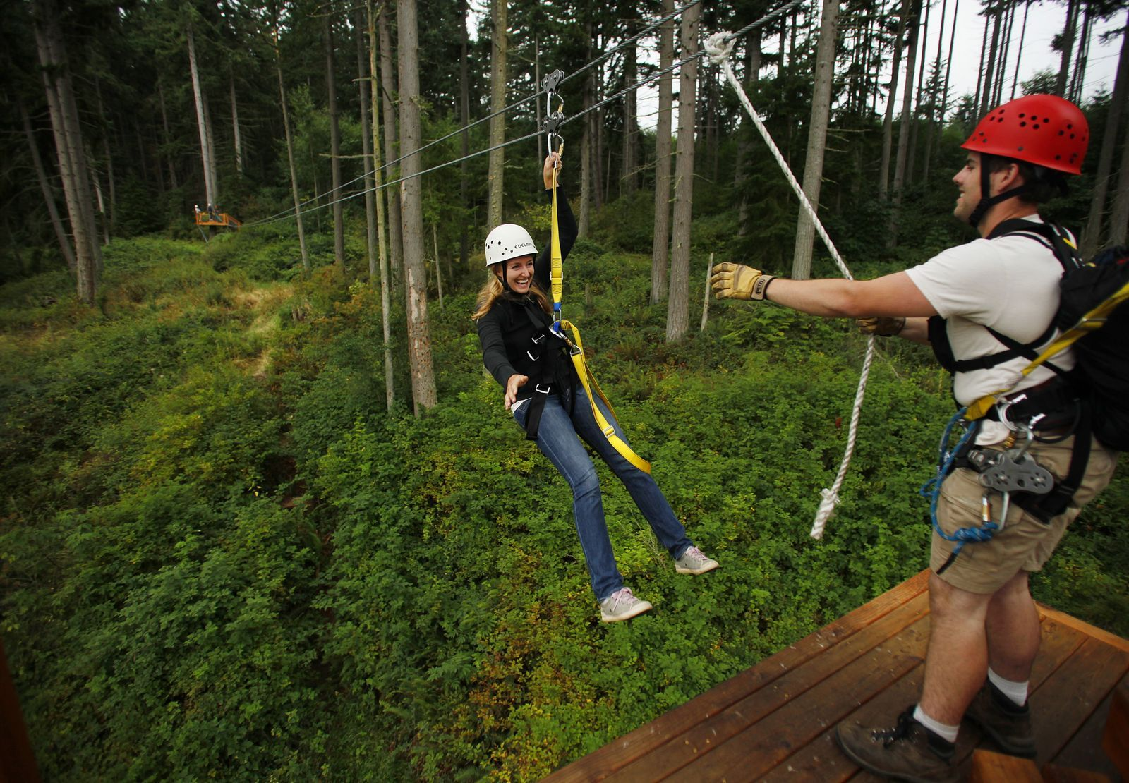Mark Mulligan / The Herald, 2011 fileJulia Kristoferson smiles as she zips onto a platform manned by guide Jack Dawe while zip-lining Aug. 29, 2011, at the Kristoferson farm.