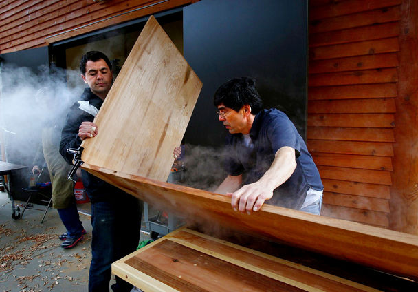 Evergreen students carve wood, imprint culture in arts program The first class of students at The Evergreen State College's new carving shed learned to make bentwood box drums from master carver David Boxley, center, over the weekend. Clifton Guthrie, left, puts a bend in his box drum after steaming the cedar board to soften the wood. Mark Harrison / The Seattle Times