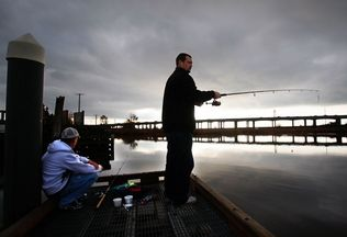 Dan Bates / Herald file photo, 2009Rob Fuller (left) and Andrew Eaton, both of Marysville, cast for sturgeon from the dock at Ebey Waterfront Park in Marysville in October 2009. Marysville has received a federal grant to help fund cleanup near the park.