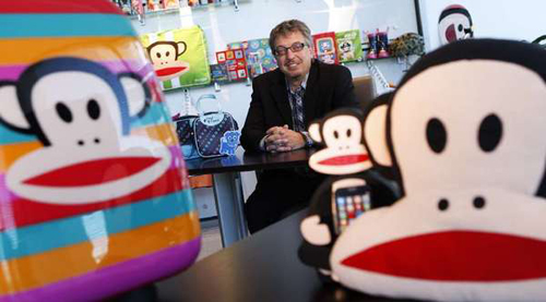 Paul Frank parent company Saban Brands President Elie Dekel surrounded by products featuring Paul Frank icon Julius the Monkey. (Genaro Molina / Los Angeles Times / June 19, 2013)