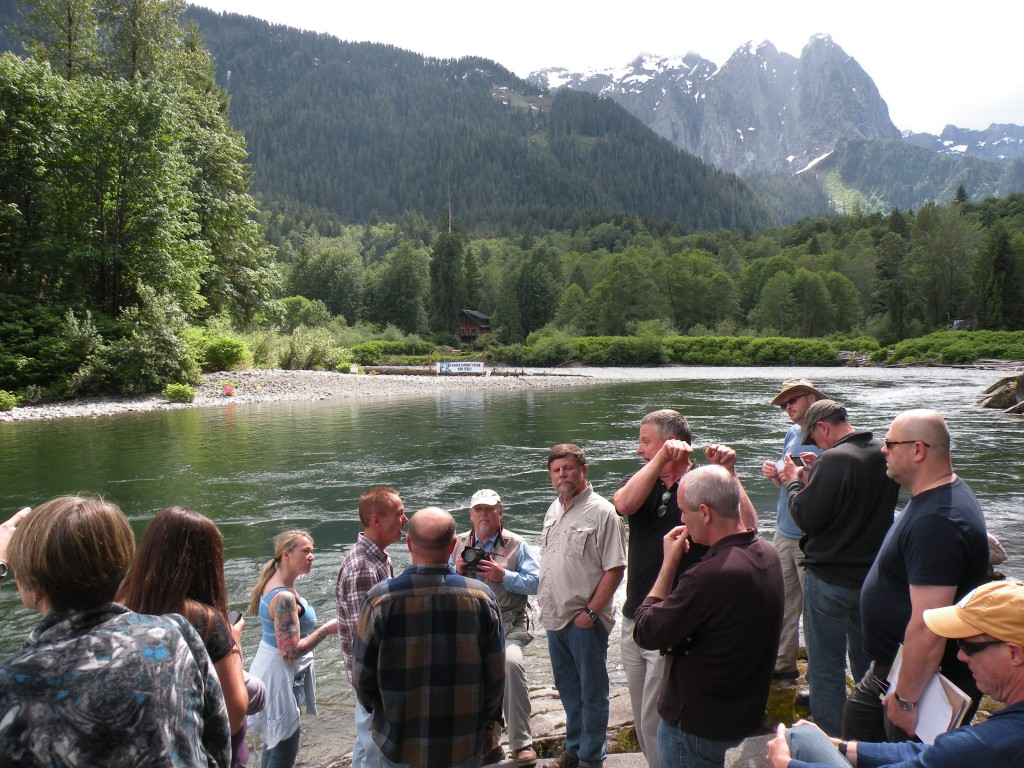 Jeff Smith (center, in tan shirt) welcomed a public tour by FERC and the PUD at his property, which borders on the proposed dam site.Bellamy Pailthorp / KPLU News