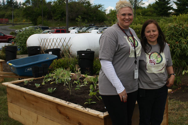 Monica Hauser (left), diabetes educator and Veronia Leahy, diabetes program coordinator at the Tulalip Health Clinic, at the site of the newly opened health clinic garden on June 11.