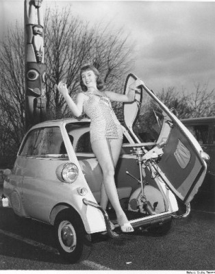Richards Studio Collection : On March 11, 1958, Miss Tacoma Home Show of 1958, Marilyn Ganes, was photographed leaning out of the front door of a BMW Isetta 300 parked near the Tacoma Totem Pole.