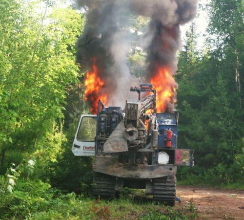 Shot-hole driller ablaze down the Bass River road. Photo: Miles Howe