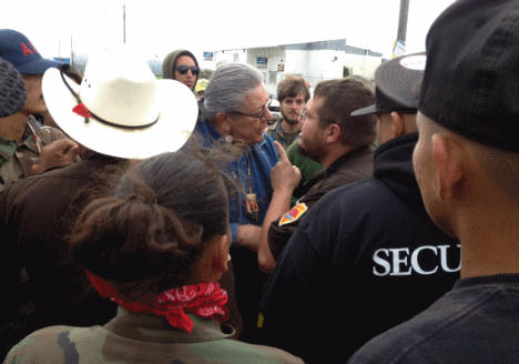 Oglala Sioux president Brian Brewer being harassed before arrest. Photo: Intercontinental Cry