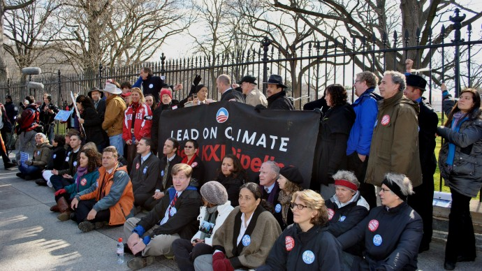 Anti-Keystone XL protesters stage a sit-in in front of the White House in Washington, D.C. on February 13, 2013. Thousands have pledged to engage in civil disobedience along the pipeline's proposed route. (Photo/chesapeakeclimate via Flickr)
