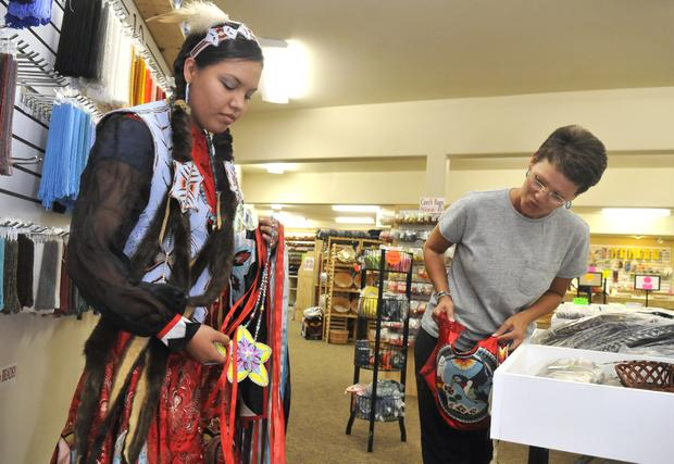 Allyssa Haynes, left, shows Peggy Mahoney her beaded medallion at the Four Shells store in Plummer, Idaho, on Monday. Haynes works at the store, which is run by Mahoney's family. It is one of the few places where Native American crafters can find almost any material needed for Indian regalia worn at traditional gatherings.Jesse Tinsley photo