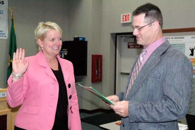 Kirk BoxleitnerDr. Becky Berg is sworn in as superintendent of the Marysville School District by Marysville School Board President Chris Nation on July 8