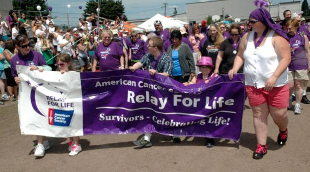 Kirk BoxleitnerCancer survivors kick off the 2013 Marysville Tulalip/Relay For Life with the opening lap at Asbery Field on June 29.