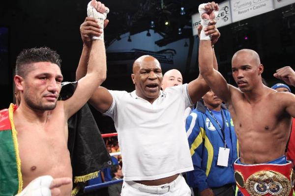 Photo courtesy Tom Casino, Iron Mike ProductionsArash Usmanee, left, Mike Tyson and Argenis Mendez at the Turner Stone Resort Casino. The fight ended in a majority draw, with Mendez retaining his title as junior lightweight champion.