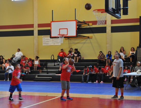 Kids were given tips from Shoni about how to improve their form as they practiced making baskets.
