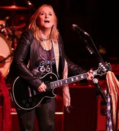Associated PressSinger-songwriter Melissa Etheridge performs on June 26 in Wilmington, Del. The folk-rocker will drop by the Tulalip Amphitheatre on Sunday.