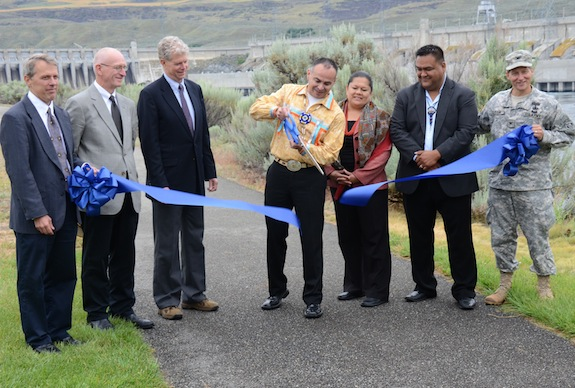 Colville Tribal Chairman John Sirois, center, cuts the ribbon for the long-awaited Chief Joseph Hatchery on the Colville Reservation, June 20, 2013. He is flanked by representatives of partner groups from the federal and tribal governments. (Photo: Jack McNeel)