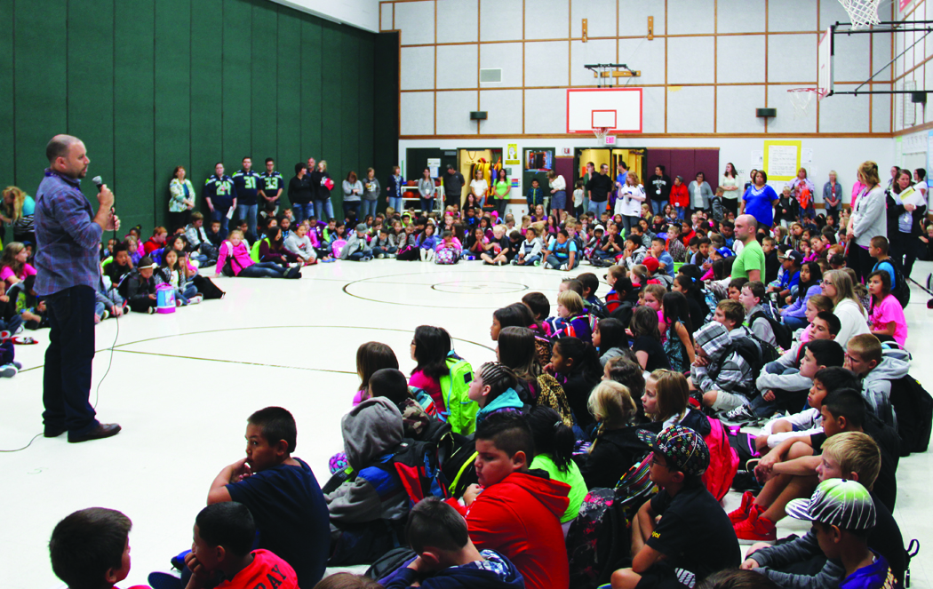 At Tulalip Quil Ceda Elementary, each day is begun with a song and a presentation of core Tulalip cultural values. Photo/Andrew Gobin