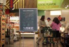 """Mark Mulligan / The HeraldWhole Foods is encouraging shoppers to """"Say Yes on 522"""" with signs and other literature distributed around its stores, including at their Lynnwood location Thursday morning."""