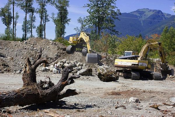 Northwest Indian Fisheries CommissionA dike is removed from Illabot Creek to restore its historic channel, one of several initiatives under way by Northwest tribes to bring back salmon habitat. This effort is by the Swinomish and Sauk-Suiattle tribes under the auspices of the Skagit River System Cooperative.