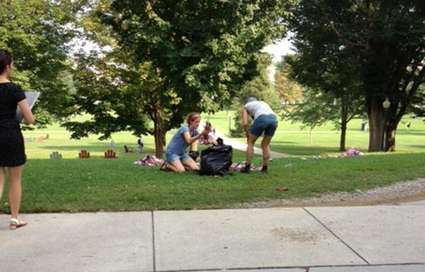 source: middbeat.org, Rachel KoganProtesters removing commemorative 9/11 flags from the Middlebury campus lawn.