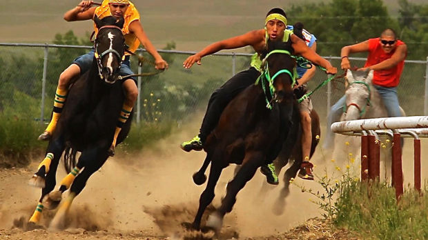 From left, Zack Rock and Luke Rock head into the home stretch during a relay race at the Crow Native Days in Crow Agency. MontanaPBS will feature the native sport in the documentary 'Indian Relay.'