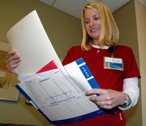 Janel Jacobson, a medical assistant at the Providence Comprehensive Breast Center in Everett, reviews a patient's charts.— image credit: File Photo
