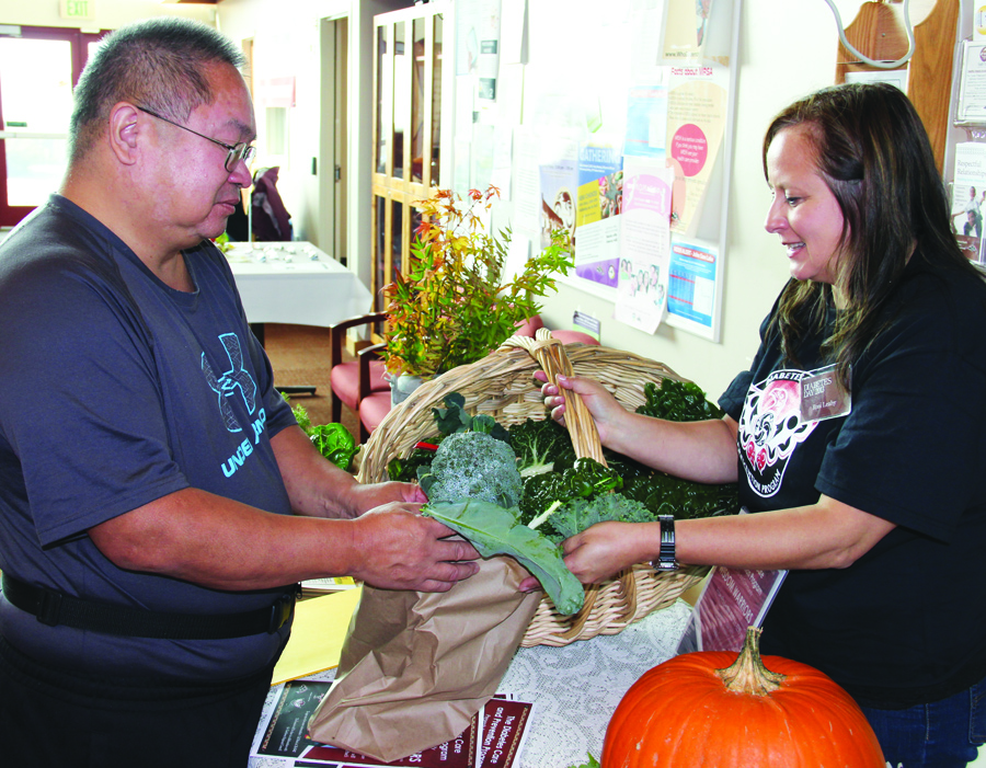 Tribal member Ron Anchetta takes home the broccoli he grew in the community garden at the health clinic.