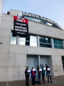 Banner drop in front the of Metro Convention Centre, where the NEB hearings are taking place this week in Toronto. Photo: Michael Toledano