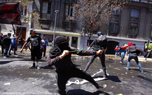 Some of the protesters threw rocks and other objects at police after the main, peaceful march earlier Saturday. Photo: Luis Hidalgo/AP