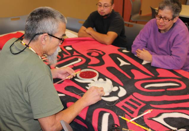 Richard Muir Jr. holds a beading seminar for Veterans Day at Hibulb. He is demonstrating the technique called Peyote Stitch.Photo: Andrew Gobin, Tulalip News