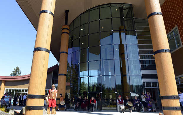 People gather in front of the new, 26,000-square-foot Nisqually Tribal Center, during a dedication ceremony, Friday May 3, 2013, in Olympia. The building, which was built opposite the tribe's previous center, will house most of the governmental services provided to tribal members. Tribal history, tradition and culture are incorporated into the building's design.(Janet Jensen/Staff photographer)JANET JENSEN — Staff photographer
