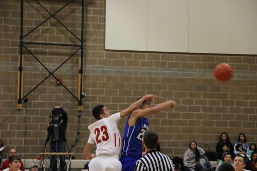 Heritage Senior Shawn Sanchey  with the tip-off over Yakima Tribal.Andrew Gobin/Tulalip News