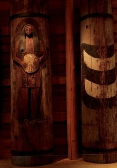Herald file, 2011These two poles carved by William Shelton stood in his original longhouse and now are at the cultural center.