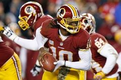 Washington Redskins quarterback Robert Griffin III turns out of the pocket during the first half of an NFL football game against the San Francisco 49ers in Landover, Md., Monday, Nov. 25, 2013. (AP Photo/Alex Brandon)