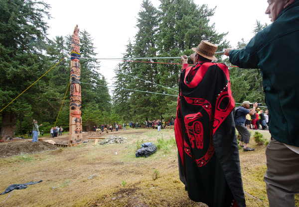 "Bruce Kirkby for The New York TimesRaising the ""Legacy Pole"" on Haida Gwaii."