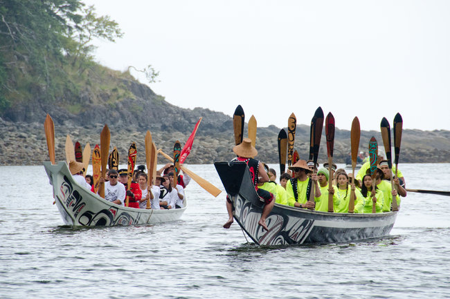Bruce Kirkby for The New York TimesTraditional Haida canoes arrive for the ceremony.