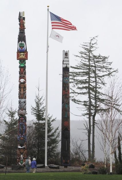 A welcome pole, right, originally carved for the Port of Olympia 15 years ago, has found a home at the Salish Cliffs Golf Course on the Squaxin Island Indian Reservation, shown Friday.TONY OVERMAN/STAFF PHOTOGRAPHERRead more here: http://www.theolympian.com/2014/01/12/2926674/benighted-totem-pole-finds-a-home.html#storylink=cpy