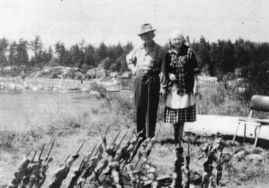 Salmon cooked traditionally, Sebastien and Eleanor Williams, Tulalip Bay by the old dining hall, now Tulalip Montessori. Totem Beach, Tulalip c.1960s. Courtesy of Mae Williams.