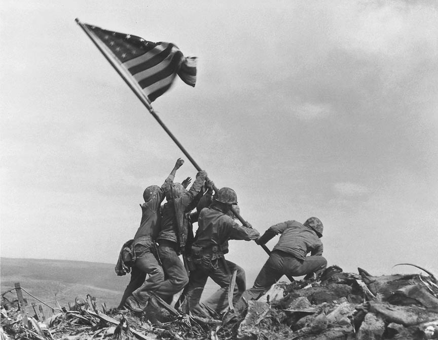 In a file photo U.S. Marines of the 28th Regiment of the Fifth Division raise the American flag atop Mt. Suribachi, Iwo Jima, on Feb. 23, 1945. Joe Rosenthal, who won a Pulitzer Prize for his immortal image of six World War II servicemen raising an American flag over battle-scarred Iwo Jima, died Sunday. He was 94.