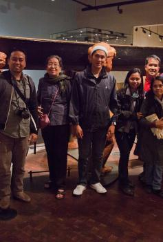 """Ancient Shores, Changing Tides"" participants in the Suquamish Museum. L to R: Janet Everts Smoak, Barbara Lawrence-Piecuch, Arvin Acosta, Carmelita Acosta, Robert Arevalo, Mariel Francisco, Enrico Cabiguen (2nd row), Mimi Cabral, Jun Cayron (1st row), Mary Barnes, Lace Thornberg.Photo by Wade Trenbeath."