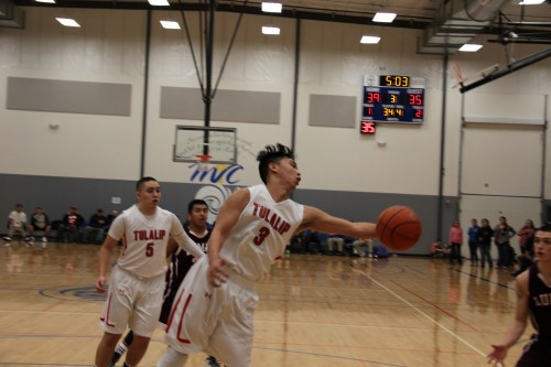 Brandon Jones with a rebound for Tulalip. This led to a 3 point shot, maintaining their lead.