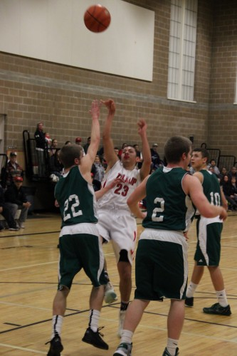 Shawn Sanchey drives to the hoop for a lay up, passing Rainier defense. Andrew Gobin/Tulalip News