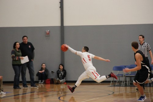 Bradley Fryberg with the save, he sprinted to the hoop for a lay up after this move.