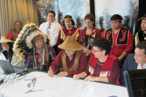 Chief Phil Lane Jr. (left) participates in the Vancouver signing of the International Treaty to Protect the Sacred From Tar Sands Projects. Photo courtesy of Phil Lane Jr.