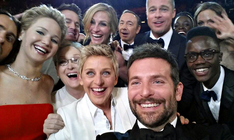 Ellen DeGeneres takes a selfie with stars at the Oscars 2014. Photograph: Ellen DeGeneres/AP