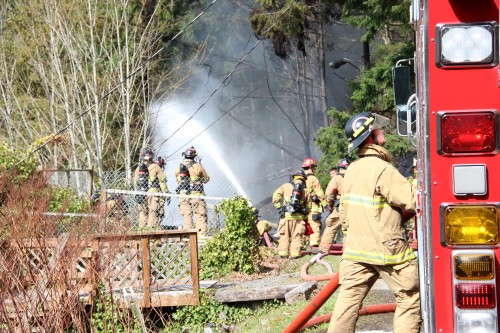 Fire Crews spray foam to smother accelerants. Andrew Gobin/Tulalip News