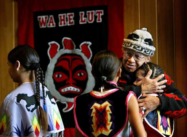 Billy Frank junior, a Nisqually Tribal elder passes out hugs in 2011 to students at Wa He Lut School in Nisqually. The school sits just off the Nisqually River at Franks's Landing, once the frontline of the Northwest fish wars in which Billy Franks was arrested many times for fishing off the Nisqually reservation. (The News Tribune file) DEAN J. KOEPFLER