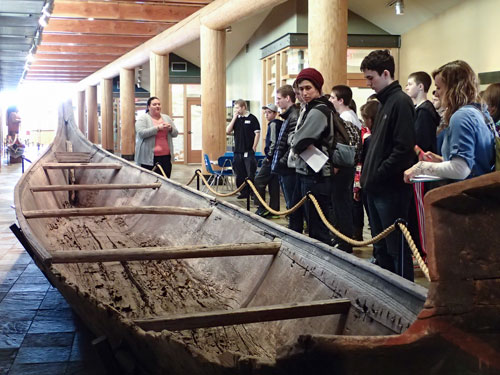 Seattle University Prep students learn about the wedding dowry canoe during a school tour on March 11. The canoe was donated to the Hibulb Cultural Center by Tulalip member Wayne Williams, and was carved around the 1880s. Photo/ Brandi N. Montreuil, Tulalip News