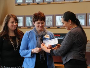 Tulalip Tribes vice-chairwoman Deborah Parker presents a donation check in the amount of $50,000 to Heather Logan of the Cascade Valley Hospital Health Foundation. The donation will be used for the Oso, WA mudslide victims' fund.Photo/ Brandi N. Montreuil, Tulalip News
