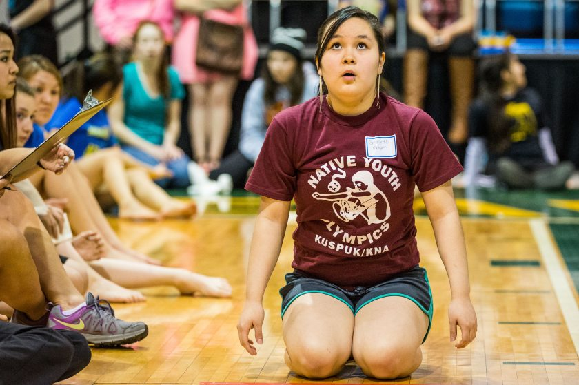 Georgette Morgan gets ready to compete in the kneel jump. Nearly 500 student athletes from across Alaska are in Anchorage this week to compete in the 44th annual Native Youth Olympics. Apr 24, 2014Loren Holmes photo