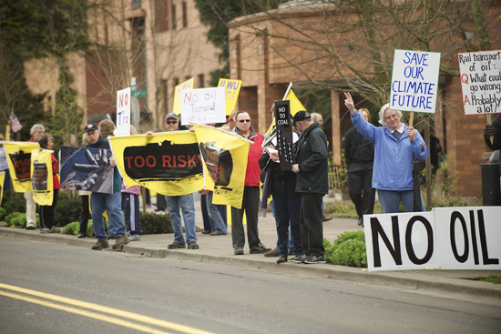 Protesters opposing an oil terminal at the Port of Vancouver gather Wednesday outside the Clark County Public Service Center before a meeting there of the state's Energy Facility Site Evaluation Council. | credit: Troy Wayrynen/The Columbian